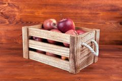 Fresh and delicious red  apples in a wooden crate on a white bac. Kground Stock Image
