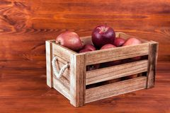 Fresh and delicious red  apples in a wooden crate on a white. Background Stock Images