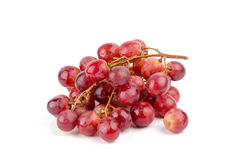 Fresh and delicious red grapes  on white background Royalty Free Stock Image