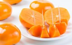 Fresh, delicious, ripe, organic Fuyu Persimmon Stock Image