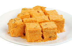 Fresh delicious soan papdi sweets. Soan papdi is a square shaped sweet with flaky fibrous texture royalty free stock photos