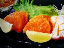 Fresh and delicious sushi plate. Fresh delicious sushi plate roll background food black asian stone japanese salmon avocado meal nigiri raw fish seafood rice stock images