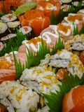 Fresh and delicious sushi plate. Fresh delicious sushi plate roll background food black asian stone japanese salmon avocado meal nigiri raw fish seafood rice royalty free stock images