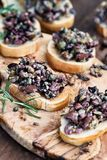 Fresh Delicious Tapenade on Toasted Bread. Homemade mixed Olive Tapenade made with garlic, capers, olive oil, Kalamata, black and green olives spread over stock images