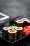 Fresh delicious tuna maki sushi rolls on dark background Royalty Free Stock Image