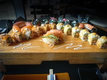 Fresh and delicious variety of maki and nigiri sushi and sake glass stock image