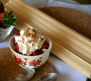 Fresh dessert with strawberries and whipped cream on a bowl. Stock Images
