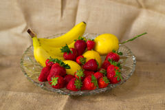 Fresh detailed fruit - bananas, lemon, strawberries Stock Photo