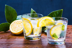Fresh detox drink, glass with lemonade and mint on rustic wood background. Stock Image