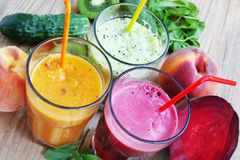 Fresh Detox Juices with Beet, Peaches, Spinach and Kiwi Fruit an Stock Images