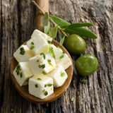 Fresh diced feta. With olives and herbs stock photography