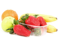 Fresh diet fruit, apple, orange, banana and strawberry Royalty Free Stock Photo