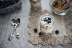 Fresh and diet muesli and yoghurt for breakfast Royalty Free Stock Images