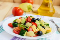 Fresh diet salad with cucumbers, tomatoes, olives cheese, bell peppers, arugula Stock Photo