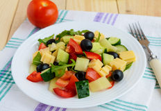 Fresh diet salad with cucumbers, tomatoes, olives cheese, bell peppers, arugula Royalty Free Stock Photo