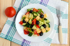 Fresh diet salad with cucumbers, tomatoes, olives cheese, bell peppers, arugula Royalty Free Stock Photos