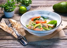 Fresh dietary salad of baked chicken breast, avocado, grapefruit slices, spinach leaves, cheese, olive oil and microgreen. Healthy food. Detox stock photography