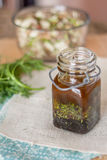 Fresh dill salad dressing. In a bottle Stock Photos