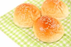 Fresh Dinner Rolls on Green Kitchen Cloth. The close up shot of some fresh dinner rolls on the green kitchen cloth Stock Photos