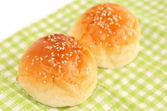 Fresh Dinner Rolls on Green Kitchen Cloth. The close up shot of some fresh dinner rolls on the green kitchen cloth Royalty Free Stock Photography