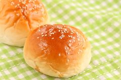 Fresh Dinner Rolls on Green Kitchen Cloth. The close up shot of some fresh dinner rolls on the green kitchen cloth Stock Images