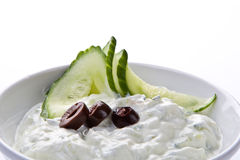 Fresh dip of Tzatziki. Fresh dip of famous Greek tzatziki with cucumber and olives royalty free stock photography