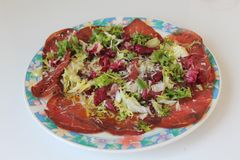 Fresh dish of bresaola, in salad Royalty Free Stock Photo
