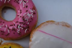 Fresh donuts with colorful glaze in the box royalty free stock image