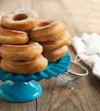 Fresh donuts with powder sugar. Royalty Free Stock Images