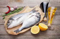 Fresh dorado fish cooking with spices and condiments Stock Photos