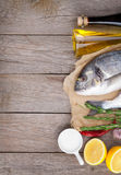 Fresh dorado fish cooking with spices and condiments Royalty Free Stock Photography