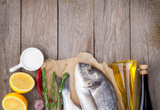 Fresh dorado fish cooking with spices and condiments Stock Photo