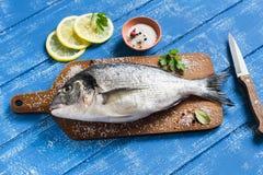 Fresh Dorado fish and lemon Stock Photography
