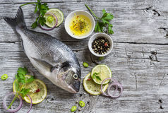 Fresh Dorado fish, lemon, lime and parsley Stock Photography