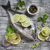 Fresh Dorado fish, lemon, lime and parsley Royalty Free Stock Images