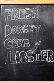 Fresh Dorset crab and lobster chalkboard sign. Royalty Free Stock Photography