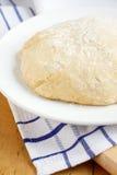 Fresh dough. Fresh pizza dough on white plate Stock Photo