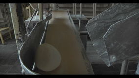 Fresh dough on assembly line stock footage