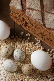 Fresh dough in flour with rye bread. Fresh dough with flour on a paper napkin decorated with rye bread flour, quail eggs and wheat grains Royalty Free Stock Images