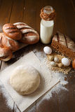 Fresh dough in flour with rye bread. Fresh dough with flour on a paper napkin decorated with rye bread flour, quail eggs and wheat grains Royalty Free Stock Photography