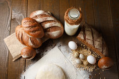 Fresh dough in flour with rye bread. Fresh dough with flour on a paper napkin decorated with rye bread flour, quail eggs and wheat grains Royalty Free Stock Image