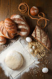 Fresh dough in flour with rye bread. Fresh dough with flour on a paper napkin decorated with rye bread flour, quail eggs and wheat grains Royalty Free Stock Photo