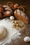 Fresh dough in flour with rye bread. Fresh dough with flour on a paper napkin decorated with rye bread flour, quail eggs and wheat grains Stock Photography