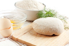 Fresh dough and its components. Wheat flour, eggs Royalty Free Stock Photo