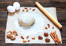 Fresh dough ready for baking on rustic wooden background. Royalty Free Stock Image
