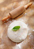 Fresh dough with a rolling pin stock photo