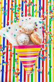 Fresh doughnuts in striped bag Stock Photography