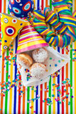 Fresh doughnuts in striped bag Royalty Free Stock Image