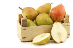 Fresh doyenné de comice pears and a cut one Stock Images