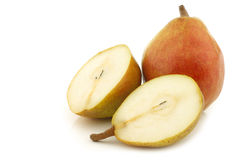 Fresh doyenné de comice pear and a cut one Royalty Free Stock Images